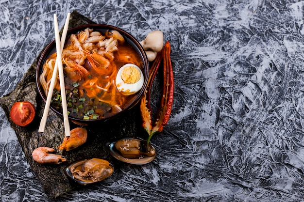 Top view seafood ramen with copy space