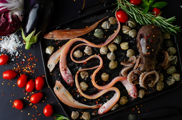 Top view of seafood with vegetables for cooking