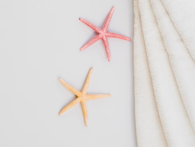 Top view seastar and towels