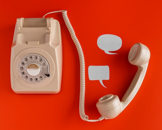 Top view of selection of chat bubbles with retro telephone