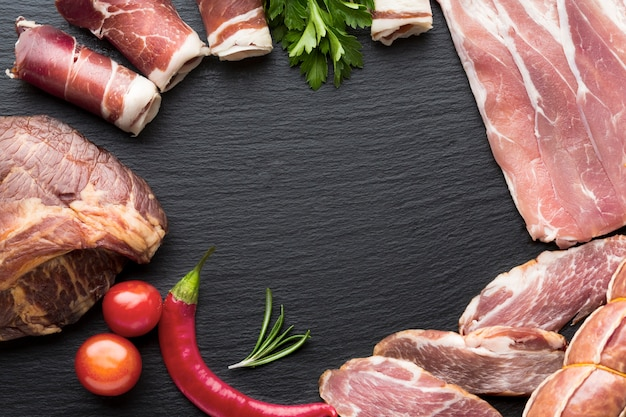 Top view selection of pork meat with copy space
