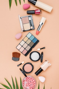 Top view set of beauty products on beige background