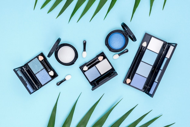 Top view set of beauty products on blue background