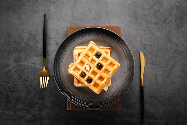 Top view set of two waffles with gold cutlery