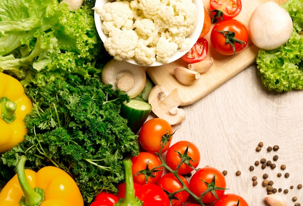 Top view of a set of vegetables on a light background