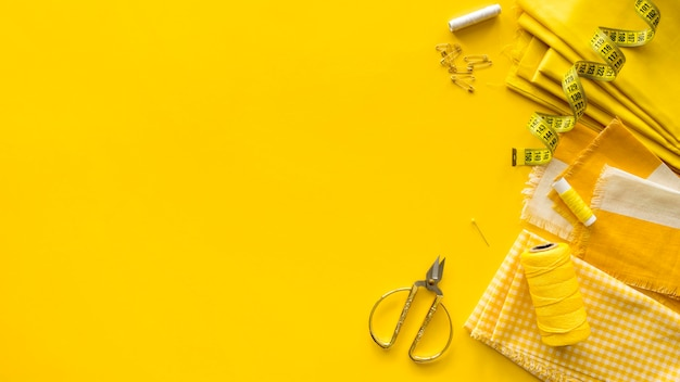 Top view of sewing essentials with copy space