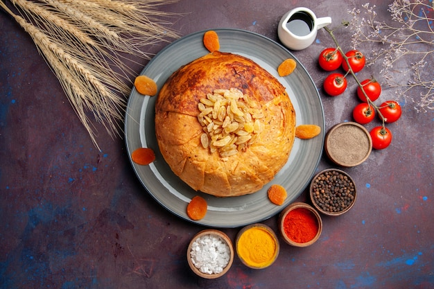 Top view shakh plov delicious eastern meal consists of cooked rice inside round dough on dark background food cuisine meal rice dough