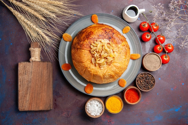 Top view shakh plov delicious eastern meal consists of cooked rice inside round dough on the dark surface food cuisine meal rice dough