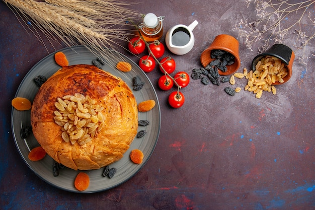 Top view shakh plov eastern meal consists of cooked rice inside round dough on dark background cuisine meal food dough rice