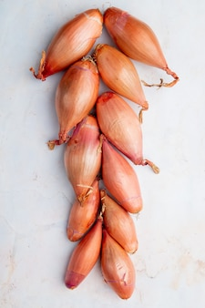 Top view of shallots on white background
