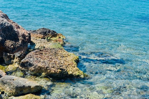 Top view shallow turquoise water of mediterranean sea. saronic islands. aegina, hydra. summer
