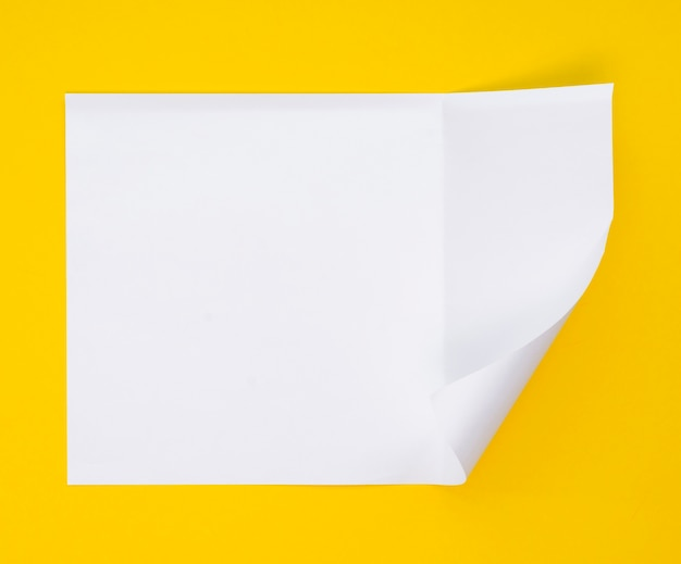 Top view of sheet of paper with bent corner