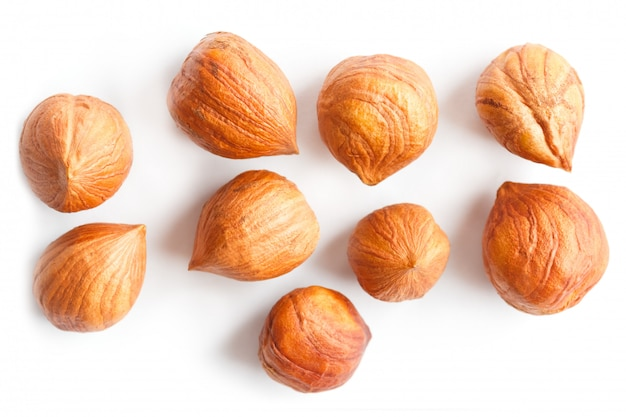 Top view of shelled hazelnuts isolated on white