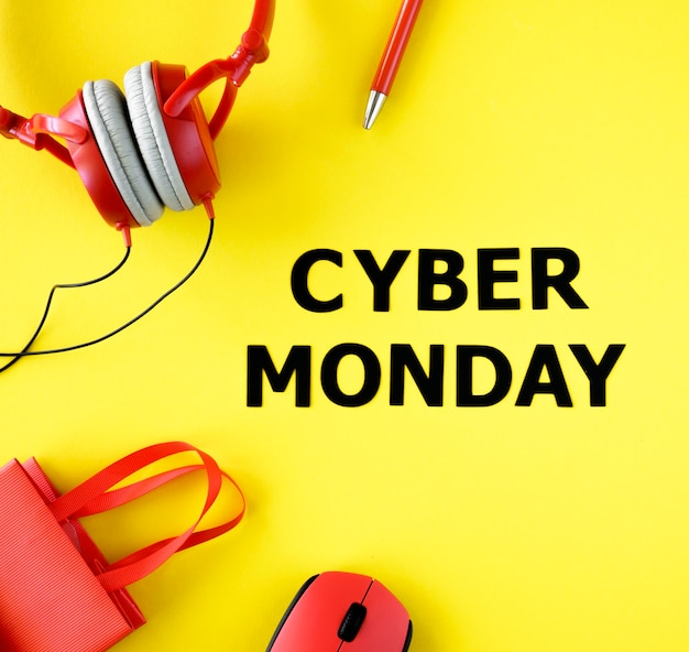 Top view of shopping bag with headphones and mouse for cyber monday
