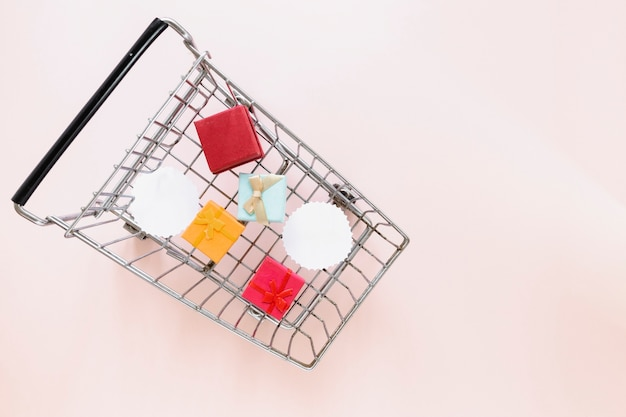 Top view of shopping cart with gifts