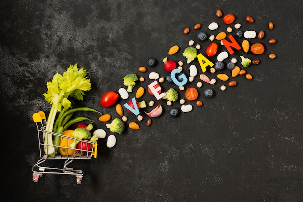 Top view shopping cart with vegetables