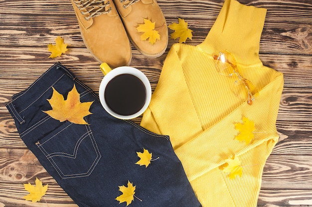 Top view shot of autumn background. fall woman`s clothes flat lay picture. woman wardrobe.
