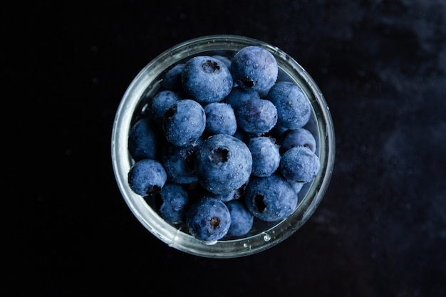 Top view shot of blueberries in a glass bowl