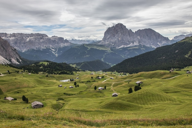Top view shot of a green valley in puez-geisler nature park in miscì, italy