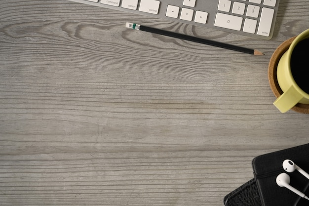 Top view shot of office wooden table top with office accessories and copy space.