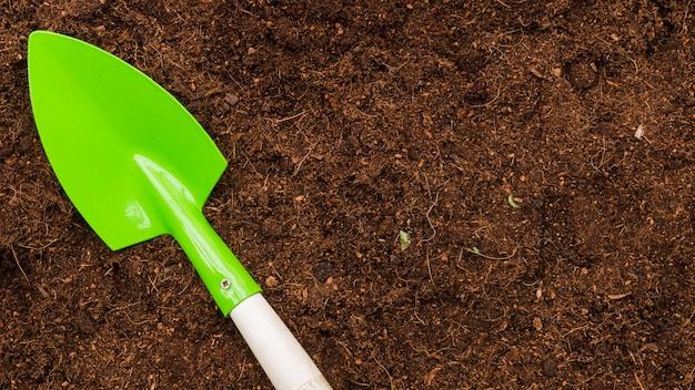 Top view shovel on soil