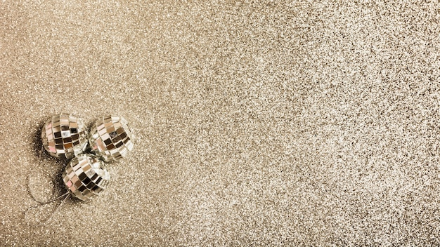 Top view silver christmas balls on granite surface