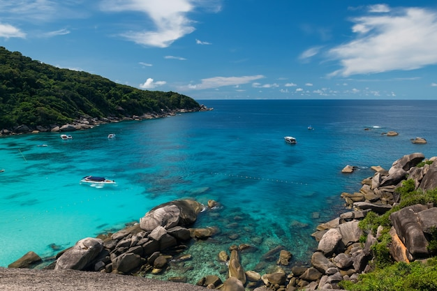 Top view of similan island, phang nga, thailand. turquoise andaman ocean, rocks, and blue sky in summer. famous travel destination.