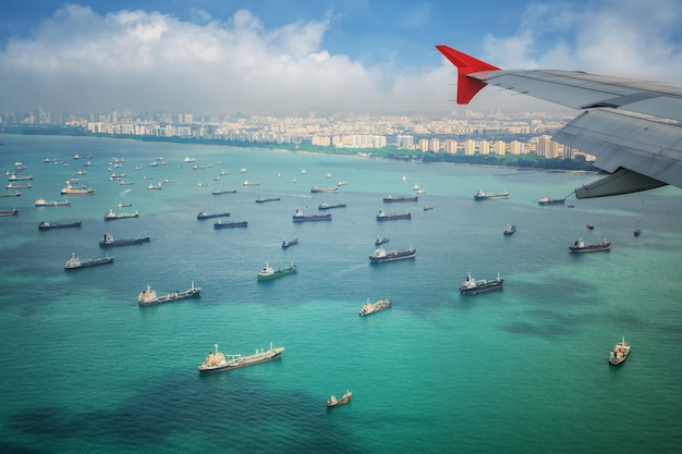 Top view of singapore port from windows of air plane