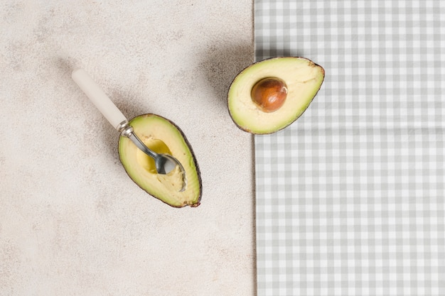 Top view of sliced avocado with seed