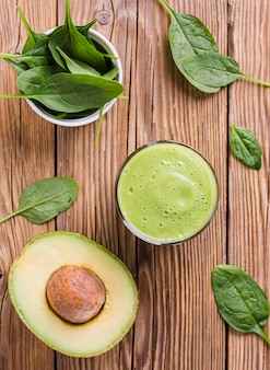 Top view sliced avocado with smoothie
