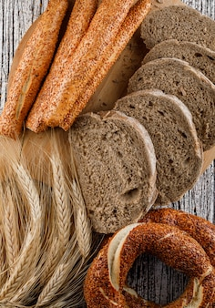 Top view sliced bread with turkish bagel, barley on wooden surface. vertical
