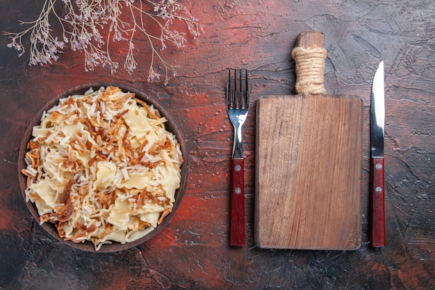 Top view sliced cooked dough with rice on dark desk meal pasta dish dough