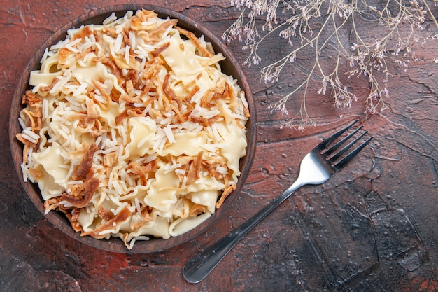 Top view sliced cooked dough with rice on dark surface meal pasta dish dough