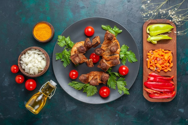 Top view sliced cooked meat with greens cherry tomatoes and olive oil on blue background