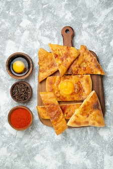 Top view sliced egg bake delicious pastry with seasonings on white background pastry bake dough meal food pizza