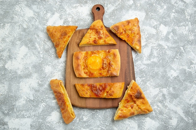 Top view sliced egg bake delicious pastry with seasonings on the white background pastry bake dough meal pizza food