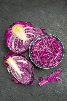 Top view of sliced red cabbage fresh vegetable on dark background