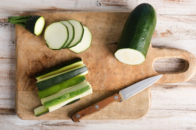 Top view sliced zucchini and a little knife