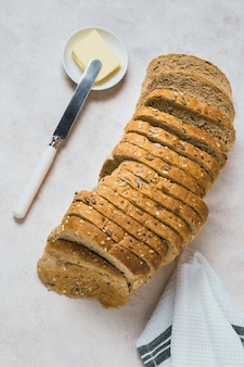 Top view slices of bread with butter and knife