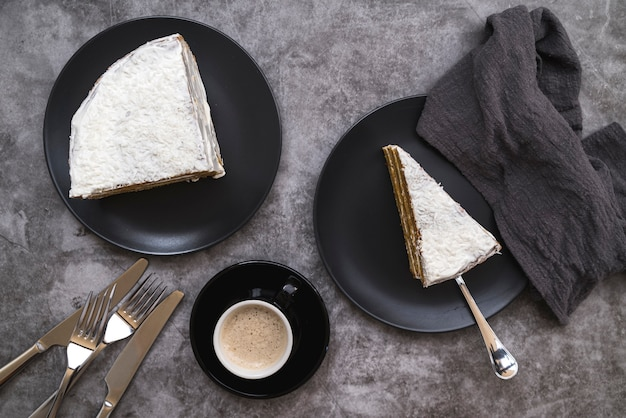 Top view slices of cake with coffee on the table