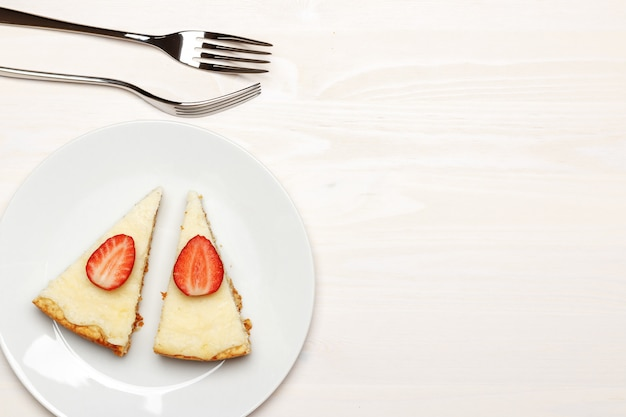 Top view on slices of cheesecake on a plate.