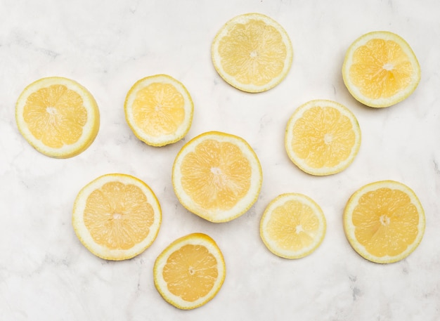 Top view slices of lemon of all sizes