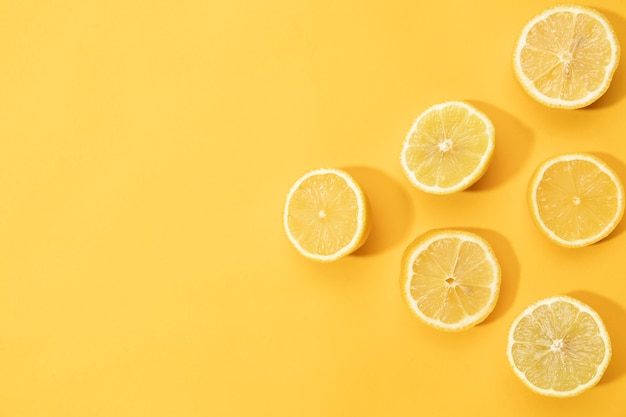 Top view slices of lemon with copy space