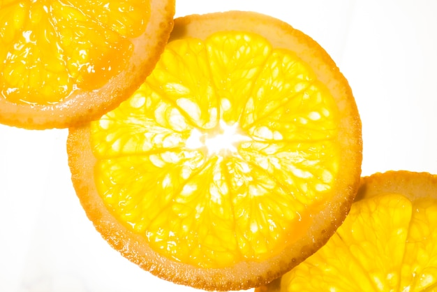 Top view slices of orange on white background