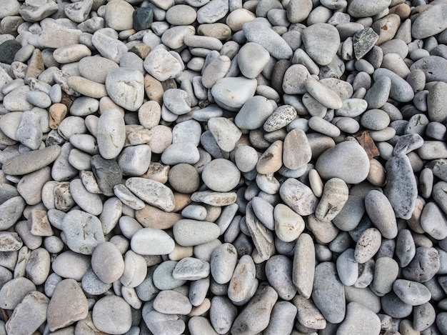 Top view of small pebble stones on the beach at daytime