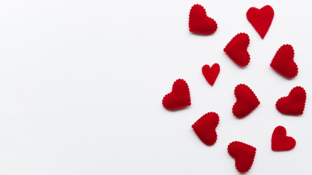 Top view small red hearts with copy-space