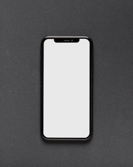 Top view of smartphone on black background