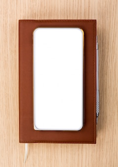 Top view of smartphone on a diary