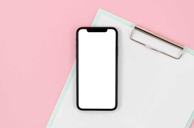 Top view smartphone template over workspace