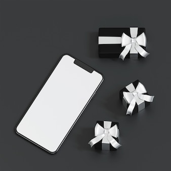 Top view of smartphone with black gift box